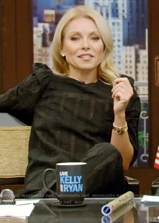 Kelly's black puff shoulder blouse and embroidered pants on Live with Kelly and Ryan