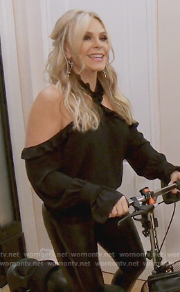 Tamra's black ruffle cross neck top on The Real Housewives of Orange County