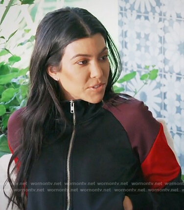 Kourtney's black striped track jacket on Keeping Up with the Kardashians