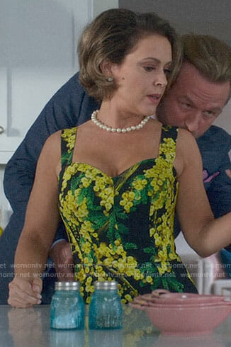 Coralee's black and yellow floral dress on Insatiable