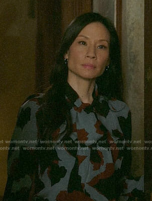 Joan's blue printed tie-neck blouse on Elementary