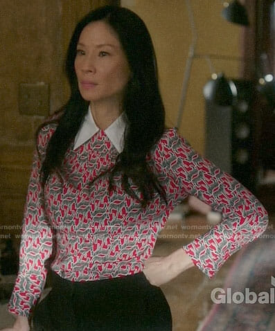 Joan's red printed top with white collar on Elementary
