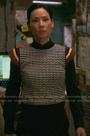 Joan's striped sleeve top on Elementary