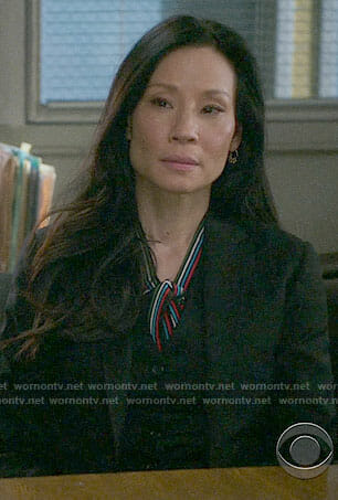 Joan's striped tie-neck blouse on Elementary
