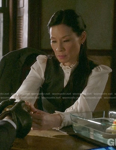 Joan's white ruffled trim blouse on Elementary