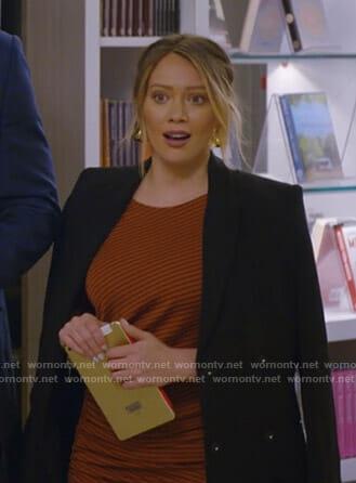Kelsey's black pearl embellished v-neck sweater on Younger