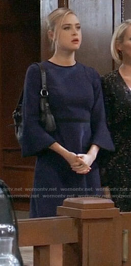 Kiki's navy bell-sleeve dress with black trim on General Hospital