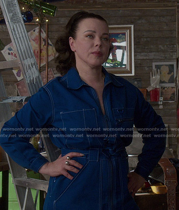 Maggie's blue jumpsuit with white stitching on Younger