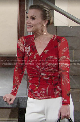 Phyllis's red floral wrap top and white trousers on The Young and the Restless