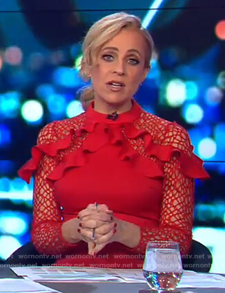 Carrie's red ruffle shoulder dress on The Project