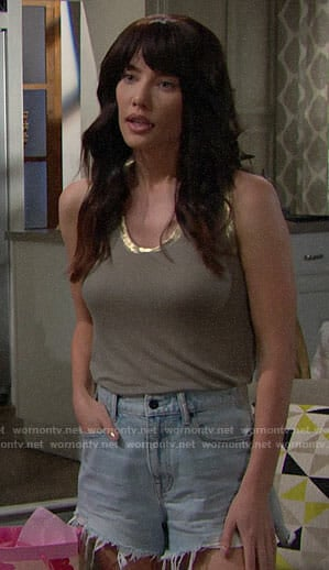 Steffy's green tank top with gold trim and denim shorts on The Bold and the Beautiful