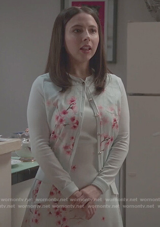 Esther's white cherry blossom cardigan and dress on Alone Together