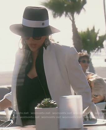 Kelly's white tie sleeve jacket on The Real Housewives of Orange County