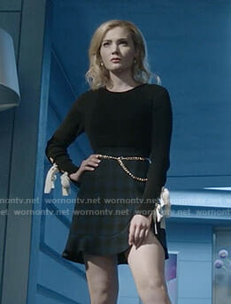 The Frost Sisters' black bow sleeve top and checked mini skirt on The Gifted