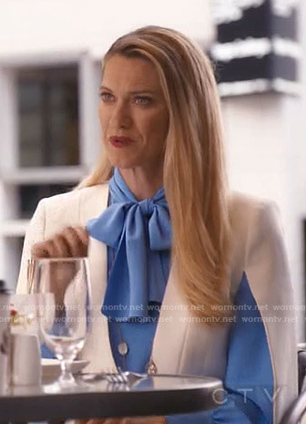 Sydney's blue tie neck blouse and cape jacket on Take Two