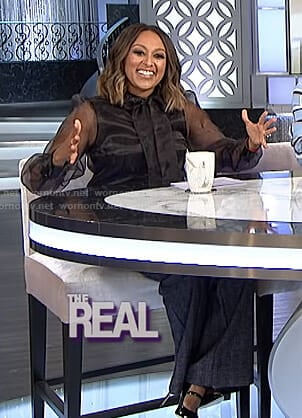 Tamera's black sheer blouse and striped trousers on The Real