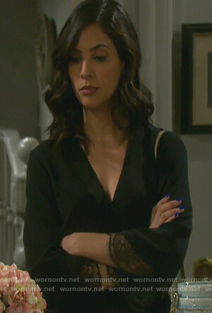 Gabi's black wrap top with lace cuffs on Days of our Lives
