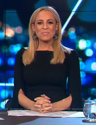 Carrie's black off shoulder split cuff dress on The Project