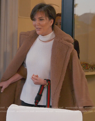 Kris's white neck cutout sweater and brown coat on Keeping Up with the Kardashians