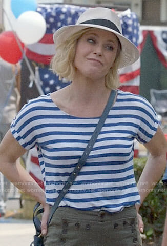 Claire's striped tee and button detail pants on Modern Family