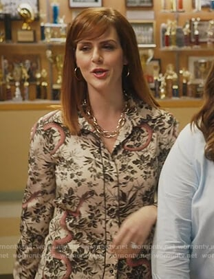 Nancy's white floral blouse on American Housewife