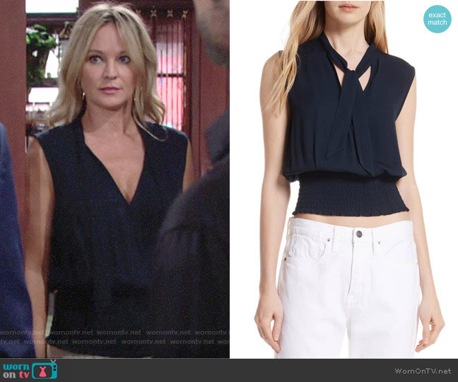 Sharon's navy top and white wide-leg pants on The Young and the Restless