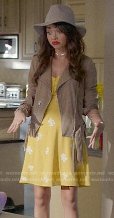 Haley's yellow dress and suede jacket on Modern Family