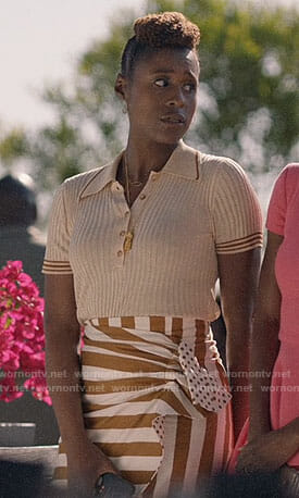 Issa's polo top and striped skirt on Insecure