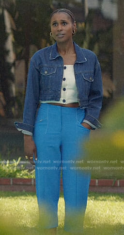 Issa's white button front top and denim jacket on Insecure