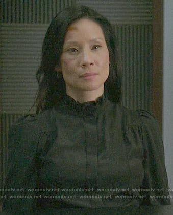 Joan's black ruffled neck blouse on Elementary