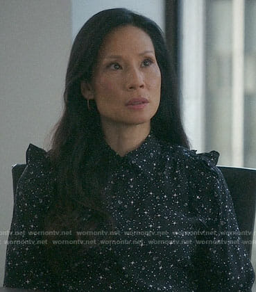 Joan's black star and diamond print blouse on Elementary