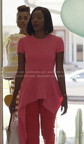 Molly's pink asymmetric peplum top on Insecure
