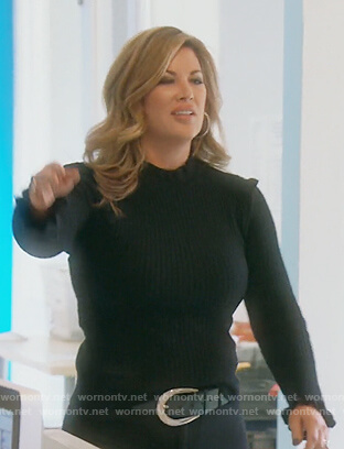 Emily's navy ruffle shoulder sweater on The Real Housewives of Orange County