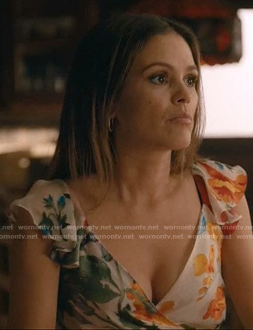 Sam's white floral wrap top on Take Two