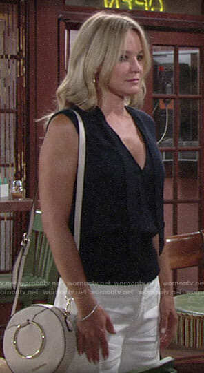 Sharon's navy smocked-waist top and white wide-leg pants on The Young and the Restless