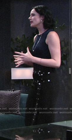 Tessa's navy top and black double belted pants on The Young and the Restless
