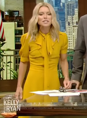 Kelly's yellow tie neck a-line dress on Live with Kelly and Ryan