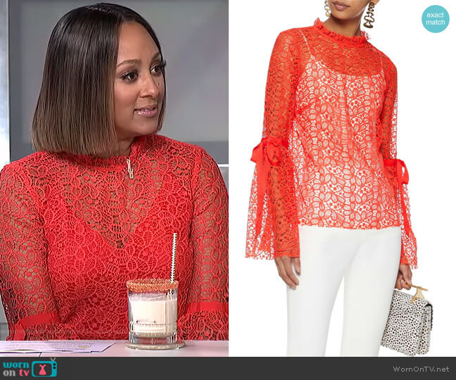 Just Lust bow-detailed lace blouse by Alice McCall worn by Tamera Mowry (Tamera Mowry) on The Real