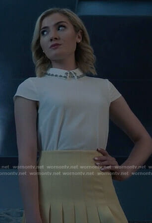 The Frost Sisters' white embellished collar top and pleated mini skirt on The Gifted