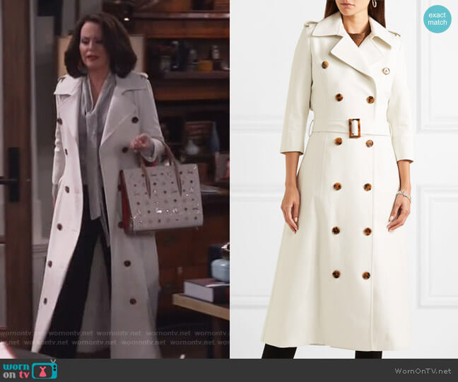 Charlotte cotton trench coat by Khaite worn by Karen Walker (Megan Mullally) on Will & Grace
