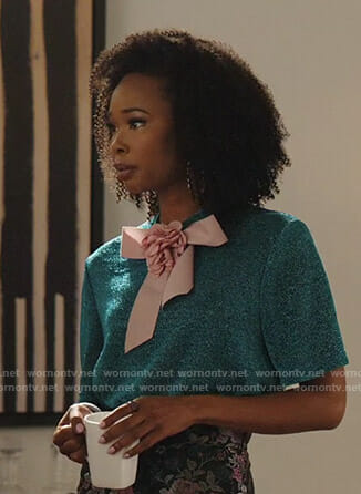 Monica's metallic short sleeve top with bow on Dynasty
