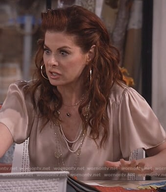 Grace's beige silk v-neck top on Will and Grace