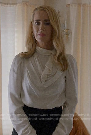Cordelia's white cowl neck blouse on American Horror Story Apocalypse