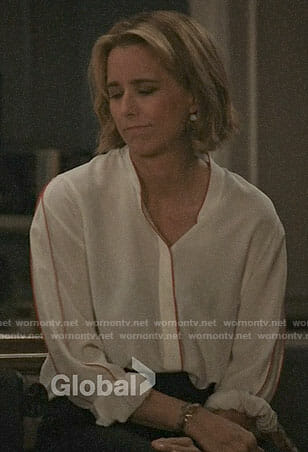 Elizabeth's white blouse with red trim on Madam Secretary