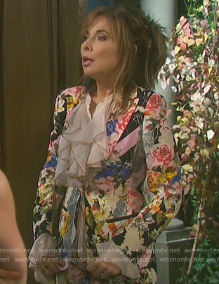 Kate's floral jacket and skirt and pink ruffle front blouse on Days of Our Lives