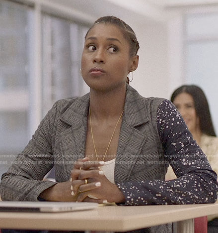 Issa's plaid and paint splatter blazer on Insecure