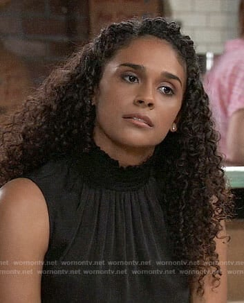 Jordan's black smocked neck top on General Hospital