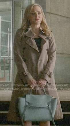 Marissa's trench coat and blue bag on Bull