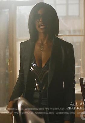 Kara's striped metallic v-neck bodysuit on Black Lighting
