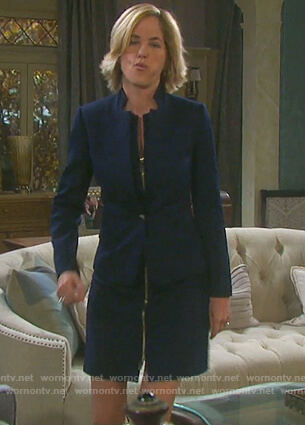Eve's navy notched collar jacket and zip-front dress on Days of Our Lives